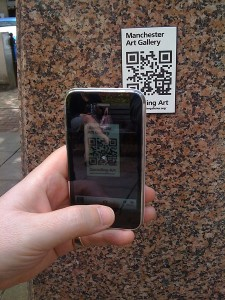 Image of smartphone and QR label